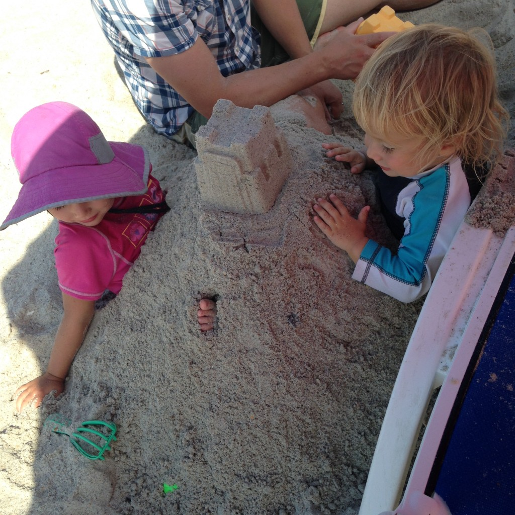 playing + building sandcastles